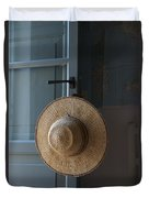 A Sun Hat Hangs On The Door Of A Tuscan Duvet Cover