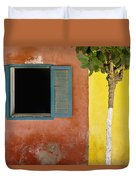A Tree Outside A Colorful Building And Duvet Cover