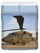 A Uh-60 Black Hawk Parked At A Military Duvet Cover