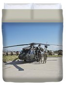 A Uh-60l Blackhawk Parked On Its Pad Duvet Cover