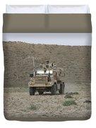 A U.s. Army Cougar Patrols A Wadi Duvet Cover
