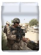A U.s. Marine Gives A Piece Of Candy Duvet Cover