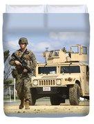 A U.s. Marine Guides A Humvee Duvet Cover