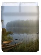 A Weathered Rowboat On The Shore Duvet Cover