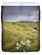 A White Wildflower Growing On A Rugged Duvet Cover