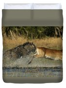 A Wildebeest And A Red Lechwe Leap Duvet Cover