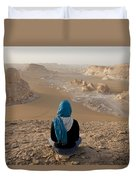 A Woman Sits Quietly On A Cliff Looking Duvet Cover