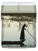 A Woman Stands At The End Of A Rowboat Duvet Cover