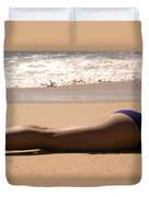 A Woman Sunbathes On The Beach Duvet Cover