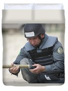 Afghan Police Student Prepares Duvet Cover
