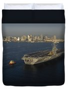 An Aircraft Carrier With The Skyline Duvet Cover