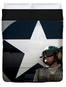 An Airman Stands In Front Of A C-2a Duvet Cover