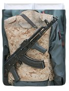 An Ak-47 Rests On The Sling Of An Duvet Cover