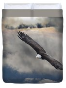 An Eagle In Flight Rising Above The Duvet Cover by Robert Bartow