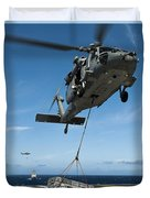An Mh-60s Sea Hawk Helicopter Lowers Duvet Cover