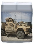 An Oshkosh M-atv Parked At A Military Duvet Cover