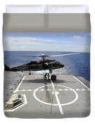 An Sh-60f Sea Hawk Helicopter Lowers Duvet Cover