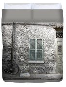 Bicycle Leaning Against A Stone House Duvet Cover