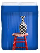 Blach And White Vase On Stool Against Blue Wall Duvet Cover