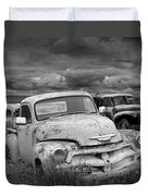 Black And White Photograph Of A Junk Yard With Vintage Auto Bodies Duvet Cover