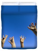 Childrens Hands Reach Toward The Blue Duvet Cover