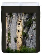 Climber Near Prehistoric Cliff Dwelling Duvet Cover