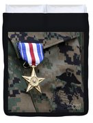 Close-up Of A Medal On The Uniform Duvet Cover
