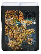 Colorful Fall Leaves Over Blue Water Duvet Cover