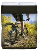 Cyclist Rides Mountain Bike Among Trees Duvet Cover