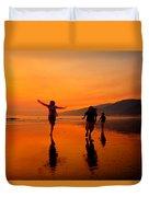 Family Running In The Beach At Sunset Duvet Cover