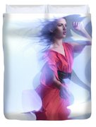 Fashion Photo Of A Woman In Shining Blue Settings Wearing A Red  Duvet Cover
