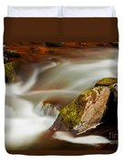 Flowing River Blurred Through Rocks Duvet Cover