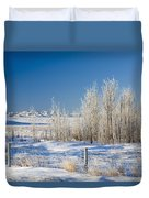 Frost-covered Trees In Snowy Field Duvet Cover
