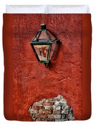 Gaslight On A Red Wall Duvet Cover