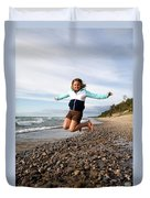 Girl Jumping At Lake Superior Shore Duvet Cover