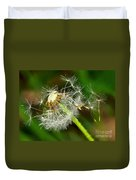 Glowing Dandelion Spores Duvet Cover