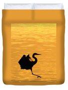Great Blue Heron Landing In Golden Light Duvet Cover