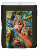 Hand Holding Butterfly Toy Duvet Cover by Garry Gay