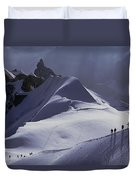 Hikers Follow Paths Across The Snow Duvet Cover
