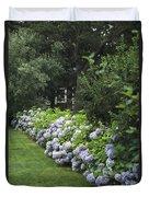 Hydrangeas In Bloom Along A Landscaped Duvet Cover