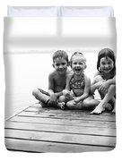 Kids Sitting On Dock Duvet Cover