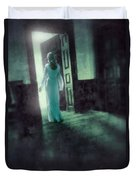Lady In White Gown Walking Through A Mysterious Doorway Duvet Cover