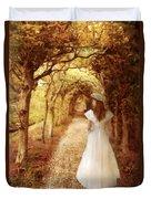Lady Walking In Tree Tunnel In Garden Duvet Cover