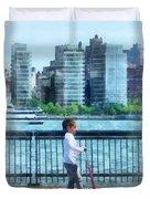 Little Girl On Scooter By Manhattan Skyline Duvet Cover