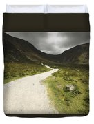 Lone Person Walking On A Path Leading Duvet Cover