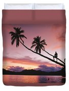 Man, Palm Trees, And Bather Silhouetted Duvet Cover
