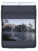 Mountain And Trees Reflected In A Foggy Lake Duvet Cover