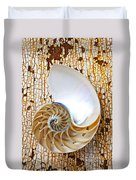 Nautilus Shell On Rusty Table Duvet Cover