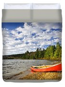 Red Canoe On Lake Shore Duvet Cover