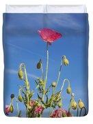 Red Flower Against Blue Sky Duvet Cover
